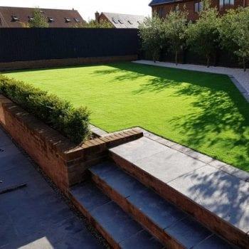 Artificial grass on top of steps in garden
